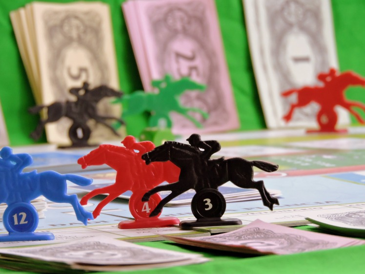 Gambling - plastic horses